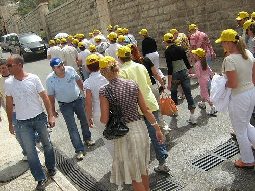 How can you update your tours for a digital world? A tour group in their yellow hats (courtesy SpecialKRB on Flickr CC)