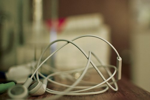 iPhone earbuds - think about audio elements for your tours (courtesy Bennigan at Flickr CC)