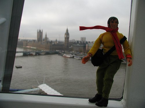 Travel Man at the London Eye, overlooking the Thames and Parliament (courtesy craigemorsels at Flickr CC)