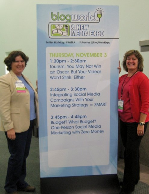 BlogWorld West Tourism track - lots of ideas! Becky McCray and Sheila Scarborough with the Day One sign.
