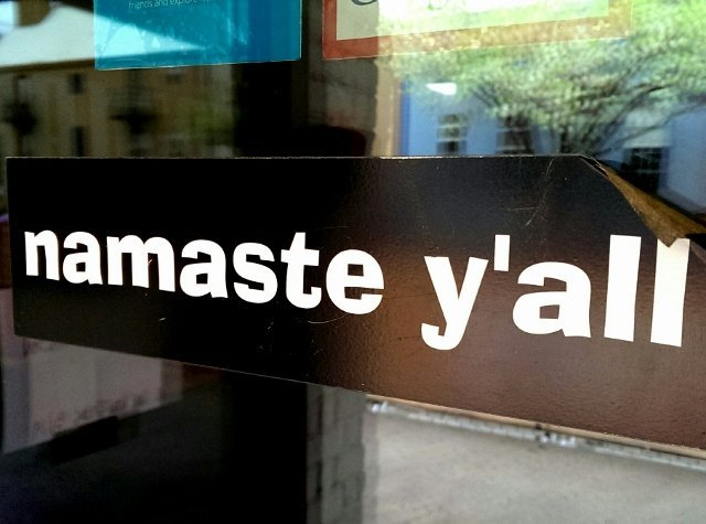 Trends in tourism mid-year update - Namaste Y'all sign at an Austin yoga studio near SXSWi (photo by Sheila Scarborough)