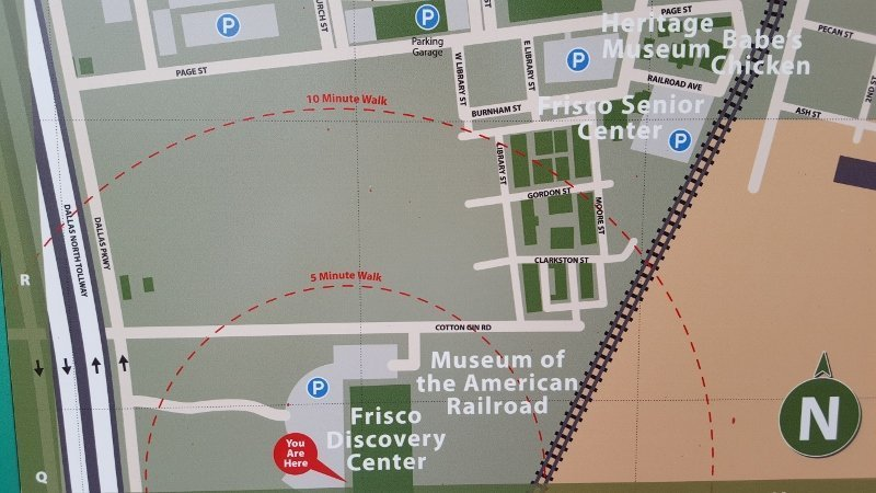 Signage showing walking distances and local attractions, which are key to Main Street marketing, outside the Frisco TX Discovery Center (photo by Sheila Scarborough)