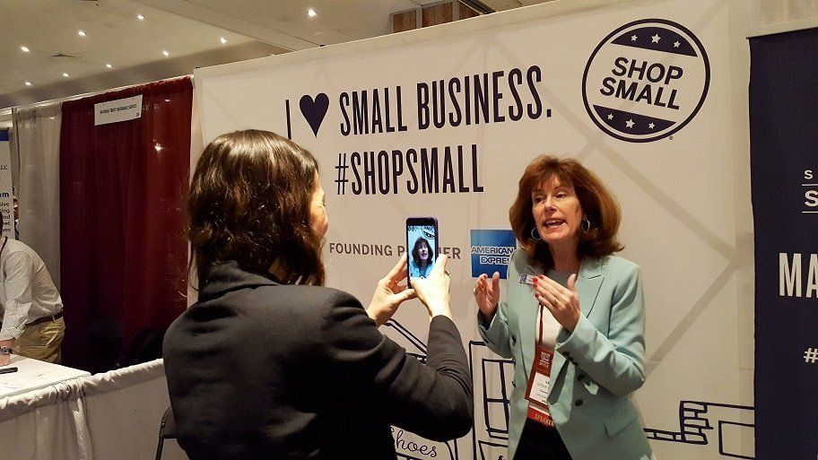 Ways social media media helps small business Leslie McLellan from Tourism Currents shoots a video testimonial for AMEX Small Business Saturday at Main Street Now conference
